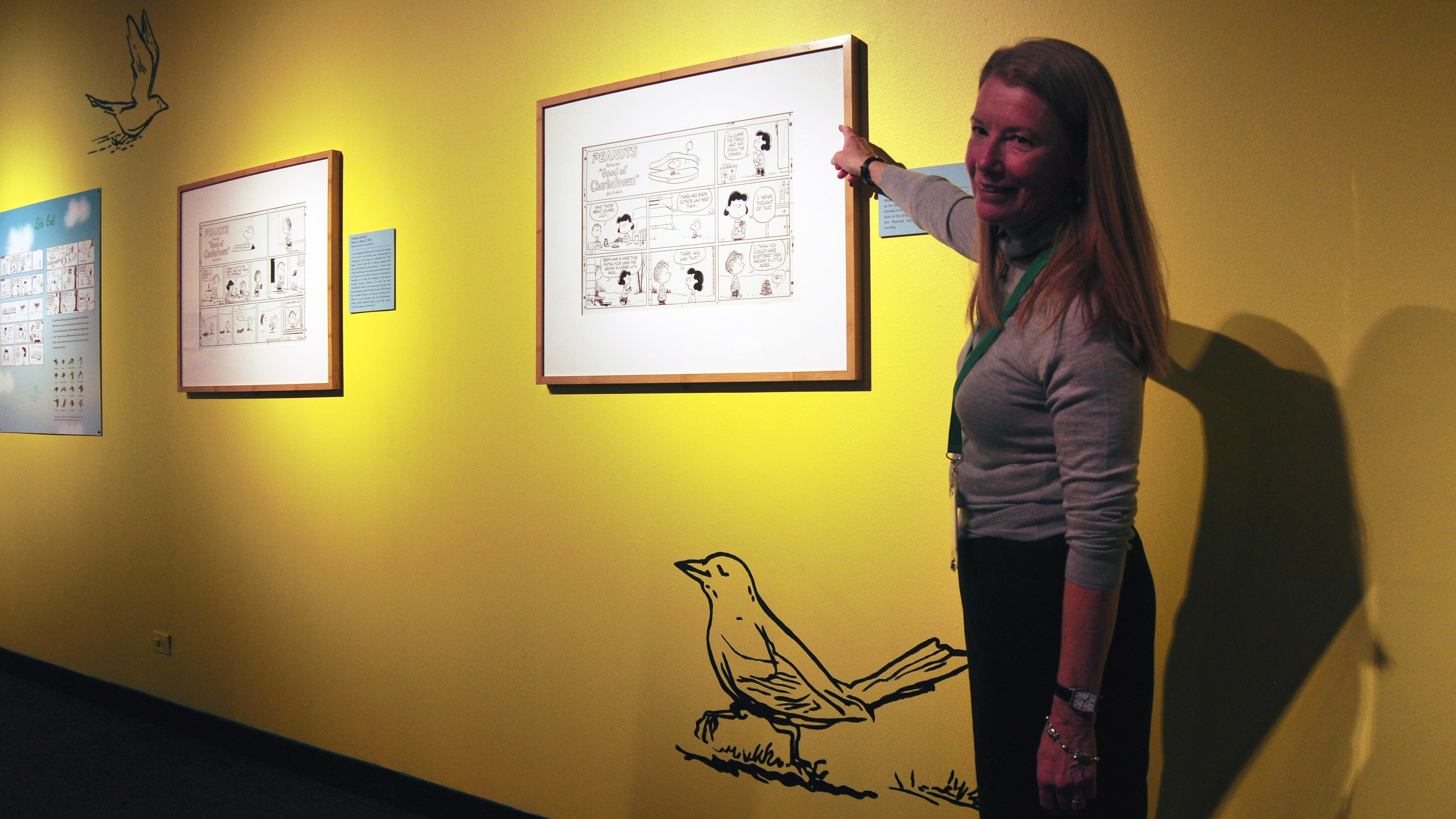 "Nature Museum President and CEO Deborah Lahey in the ""Birds"" section of the ""Peanuts ... Naturally"" exhibit (Sean Keenehan)"