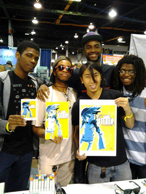 Steven Scott (back, right) and his comic team holding a copy of 12 Gauge Stereo