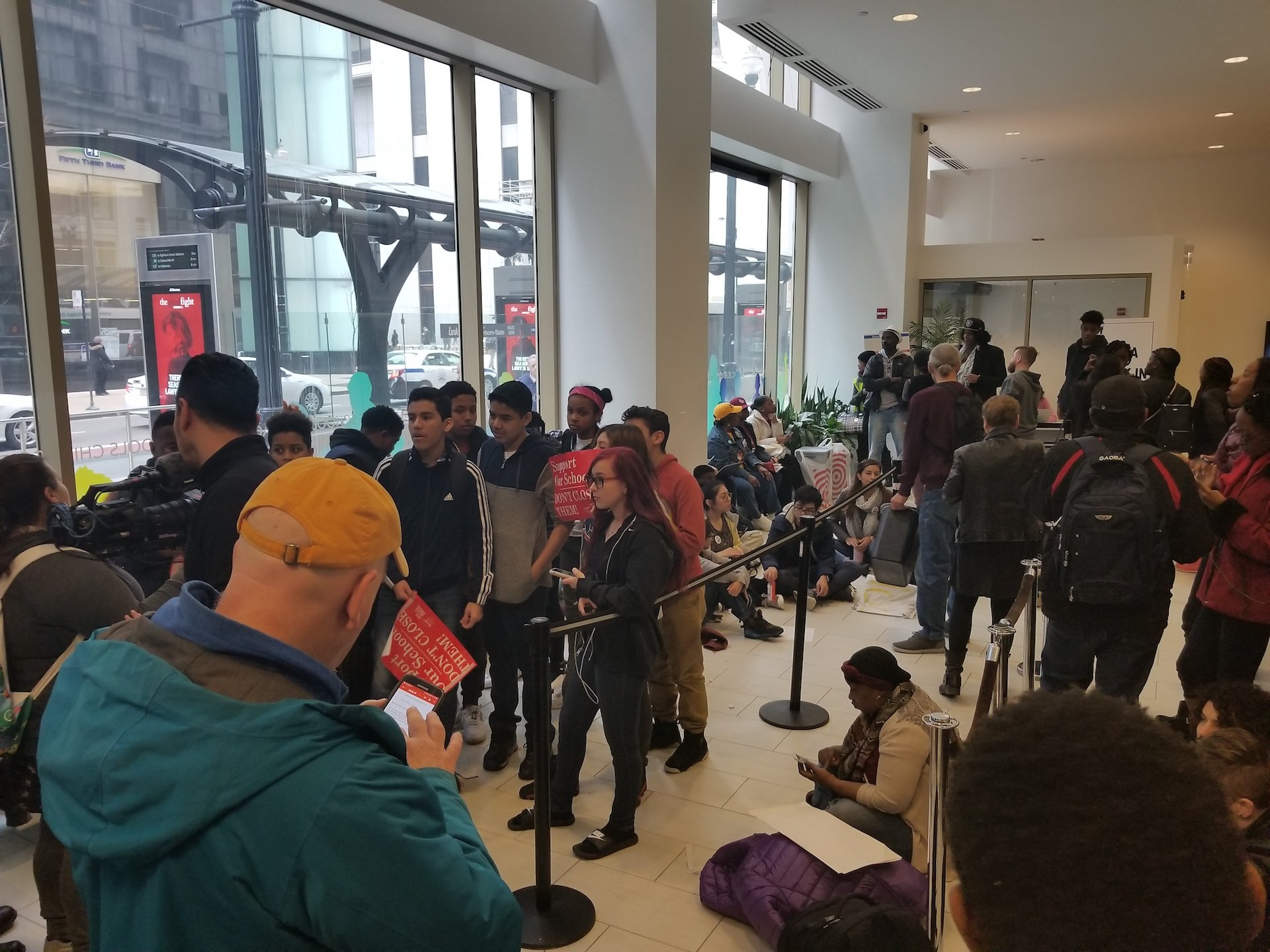 Students from the four Englewood schools packed the lobby at CPS Central Office during Wednesday's board meeting. (Matt Masterson / Chicago Tonight)