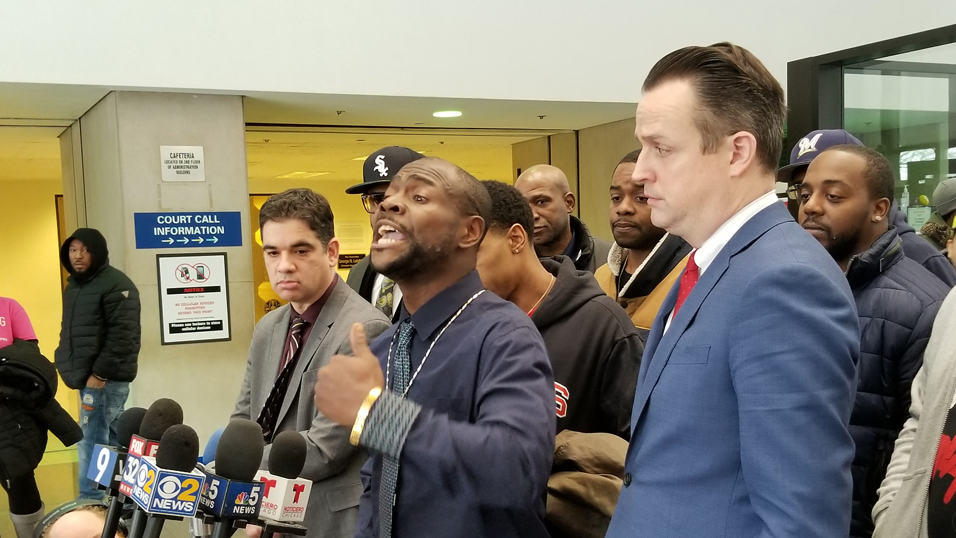 Kim Wilbourn, center, speaks to media following his exoneration Monday, Feb. 11, 2019. (Matt Masterson / Chicago Tonight)