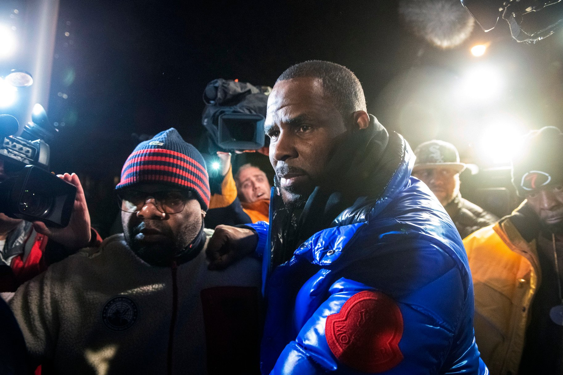 R. Kelly surrenders to authorities at Chicago First District police station on Friday, Feb. 22, 2019. (Tyler LaRiviere / Chicago Sun-Times via AP)