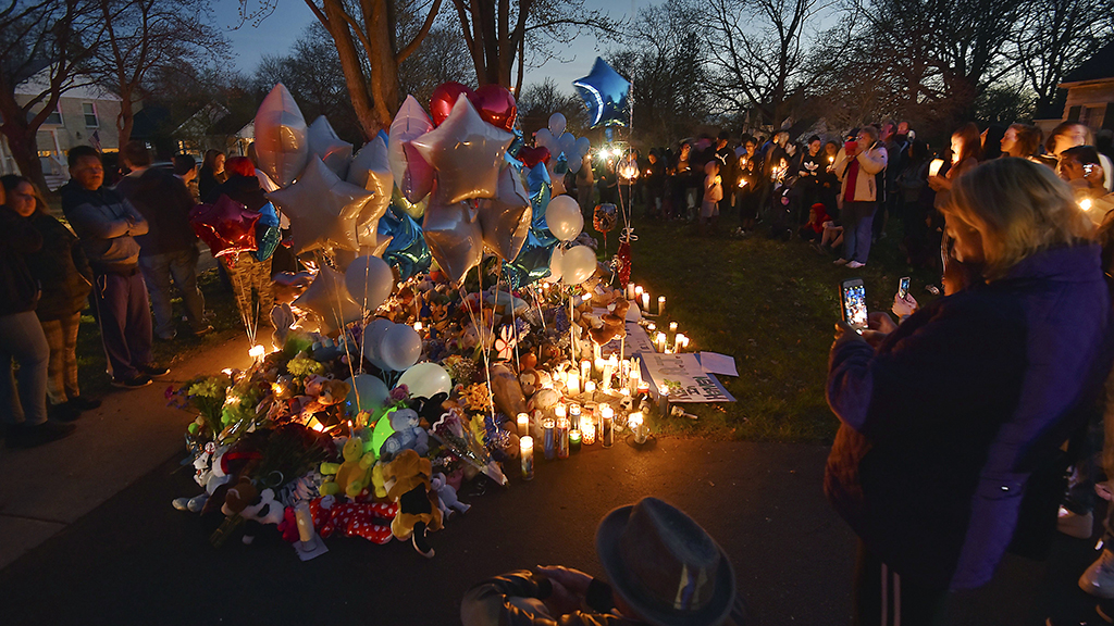 "In this Wednesday, April 24, 2019 photo, community members in Crystal lake, Illinois hold a vigil in memory of 5-year-old Andrew ""AJ"" Freund. Authorities searching for the missing boy who had lived in deplorable conditions dug up his body Wednesday and charged his parents with murder, sadly declaring that the youngster would ""no longer have to suffer."" (John Starks/Daily Herald via AP)"