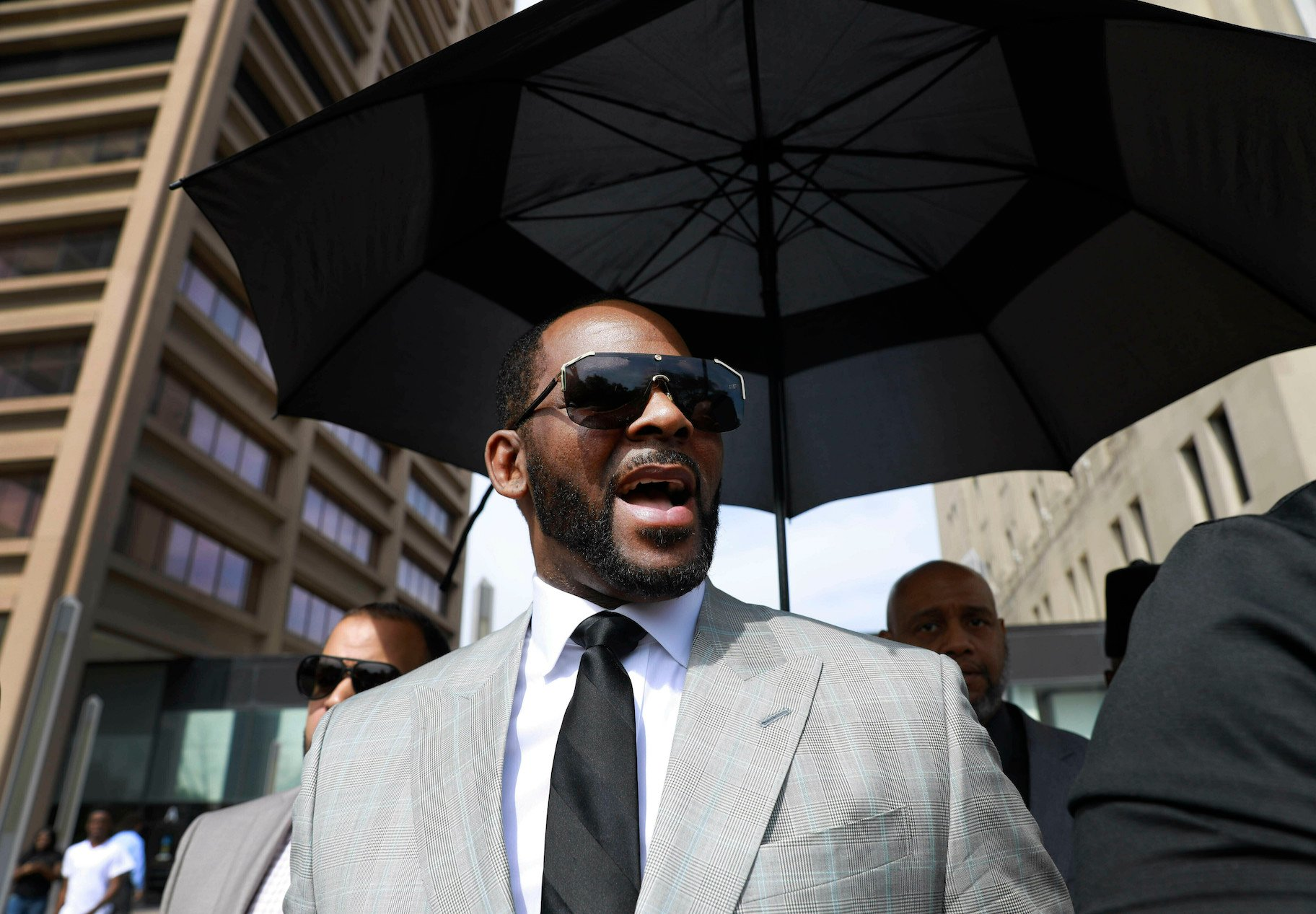 In this June 6, 2019 file photo, musician R. Kelly departs the Leighton Criminal Court building after pleading not guilty to 11 additional sex-related charges in Chicago. A U.S. Attorney's office spokesman says Kelly was arrested Thursday night, July 11 on federal sex-crime charges in Chicago. (AP Photo/Amr Alfiky, File)
