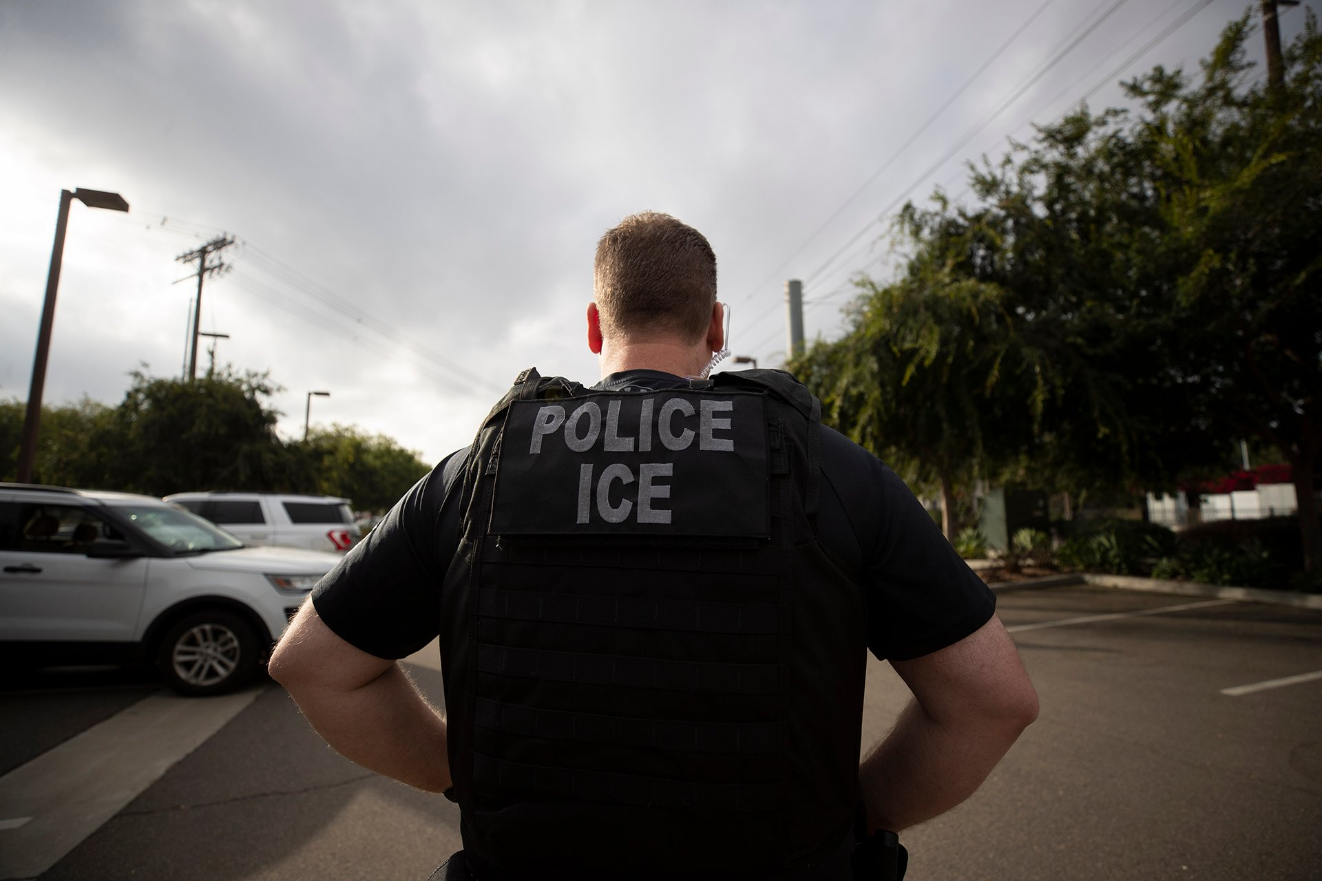 In this July 8, 2019, file photo, a U.S. Immigration and Customs Enforcement officer looks on during an operation in Escondido, California. (AP Photo / Gregory Bull, File)