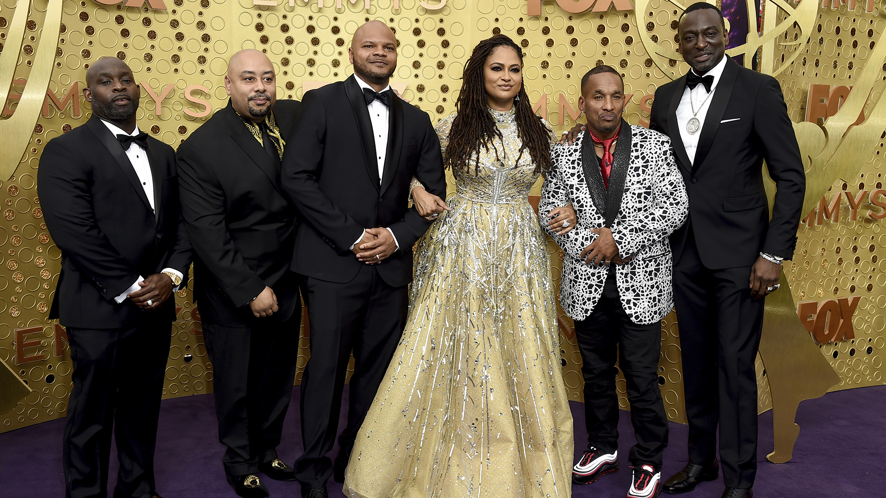 Ava DuVernay, center, is joined by Antron McCray, Raymond Santana, Kevin Richardson, Korey Wise and Yusef Salaam, of the Central Park Five, during arrivals of the 71st Primetime Emmy Awards on Sunday, Sept. 22, 2019, at the Microsoft Theater in Los Angeles. (Photo by Jordan Strauss/Invision/AP)