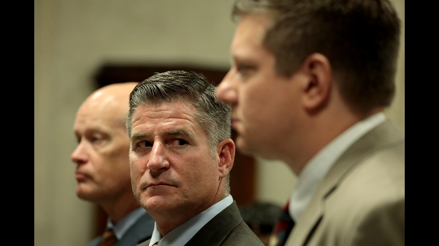 From left: Special prosecutor Joe McMahon, attorney Daniel Herbert and his client, Chicago police Officer Jason Van Dyke, attend a hearing Friday, Aug. 17, 2018. (Antonio Perez / Chicago Tribune)