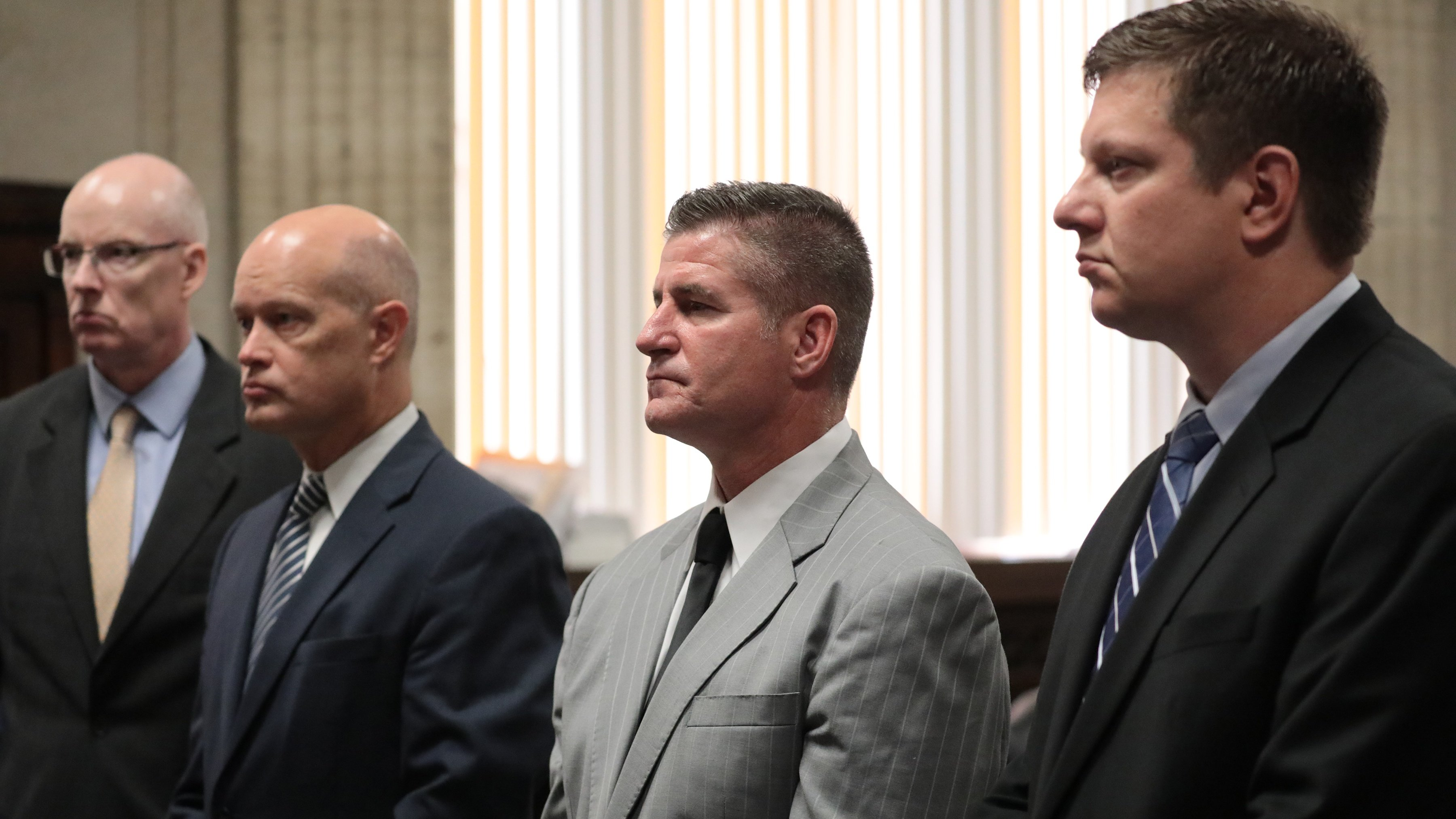 From left: Attorney Joseph Cullen, special prosecutor Joe McMahon, attorney Daniel Herbert and his client Chicago police Officer Jason Van Dyke at the trial for the shooting of Laquan McDonald at the Leighton Criminal Court Building, Friday, Sept. 14, 2018. (Antonio Perez /Pool/ Chicago Tribune)