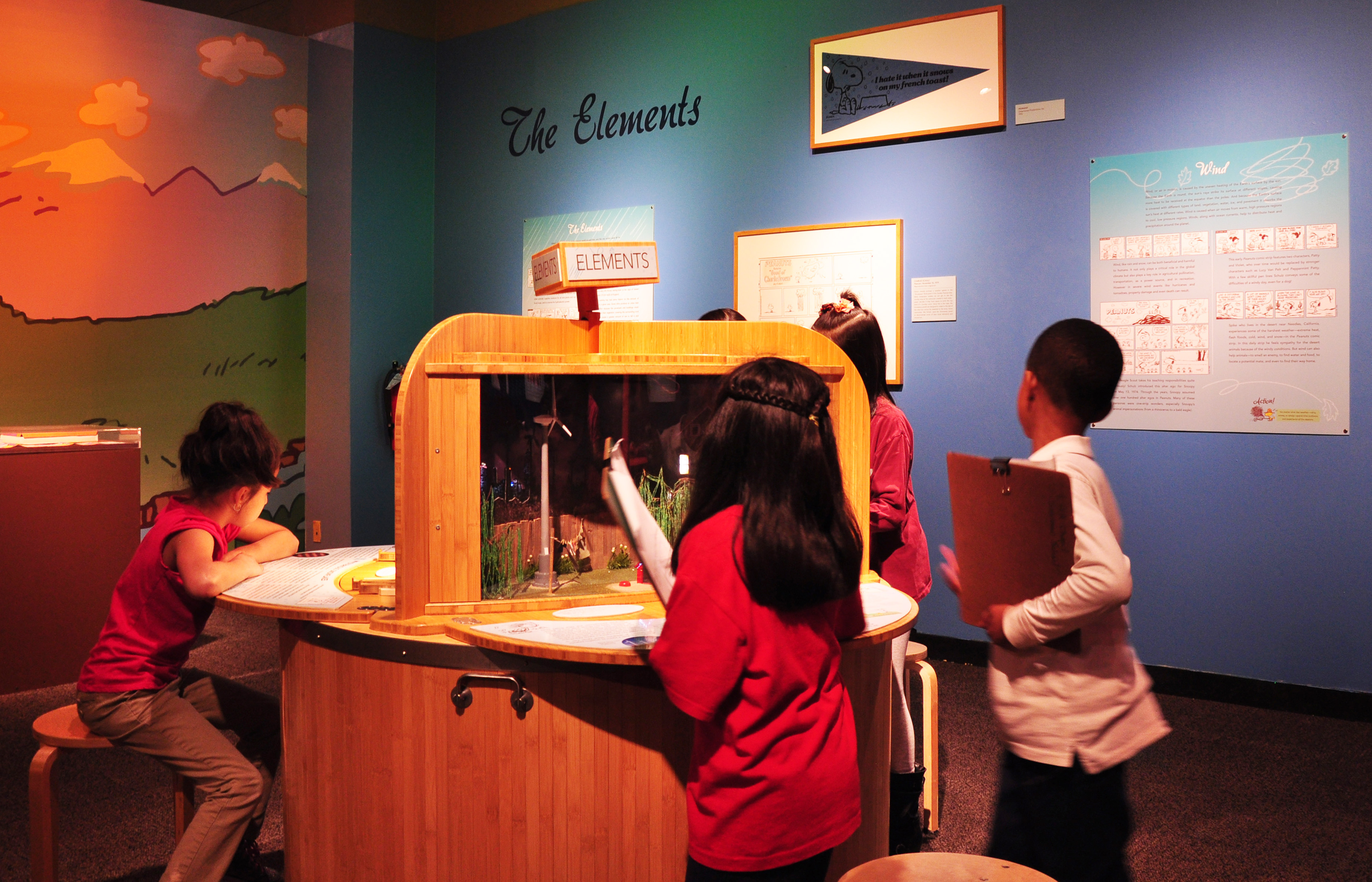 "Children learn about wind and other elements at the ""Peanuts ... Naturally"" exhibit. (Sean Keenehan)"