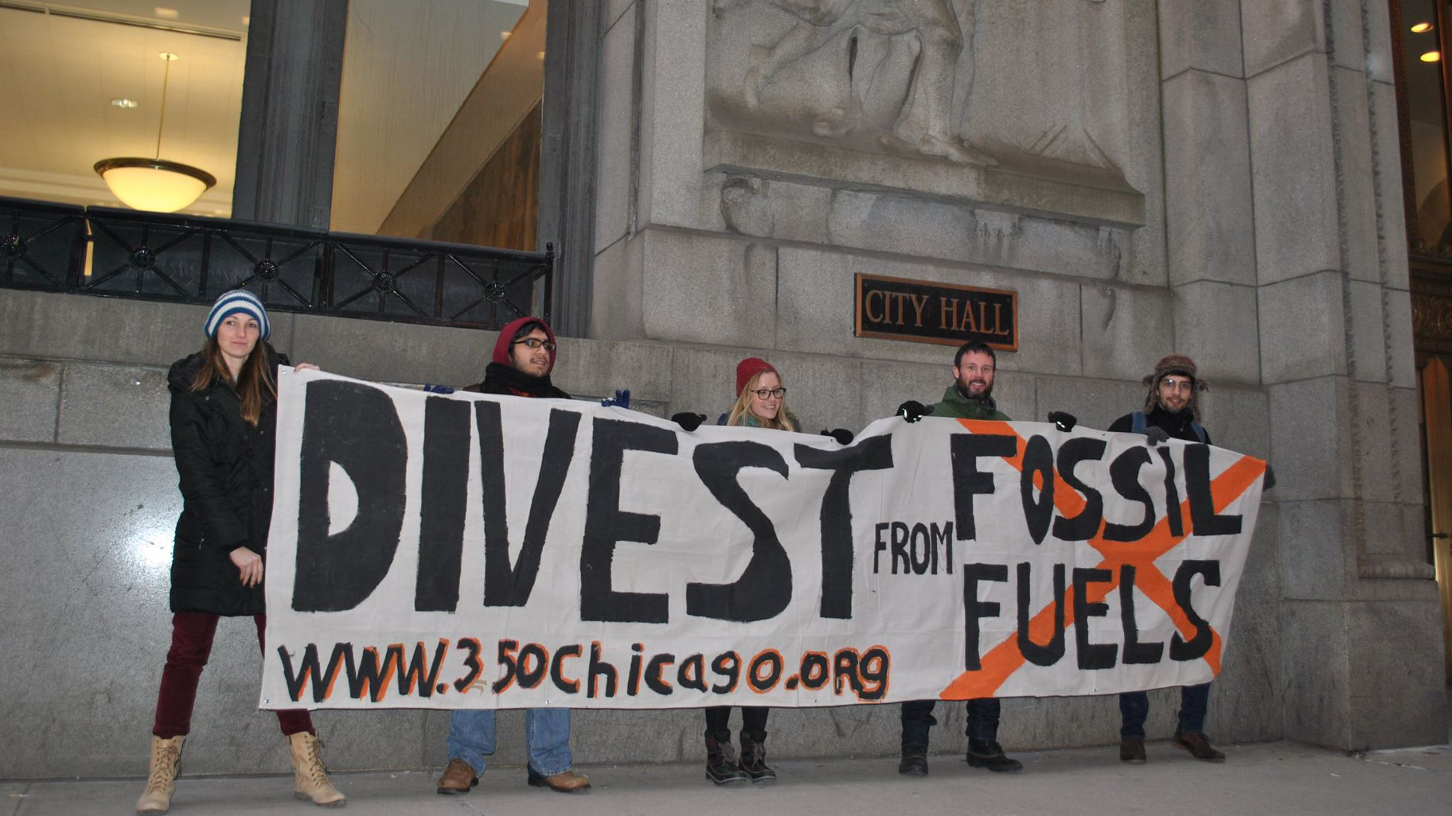 Activists from 350 Chicago protest at City Hall on Global Divestment Day, Feb. 14, 2015. (Courtesy of Melissa Brice)