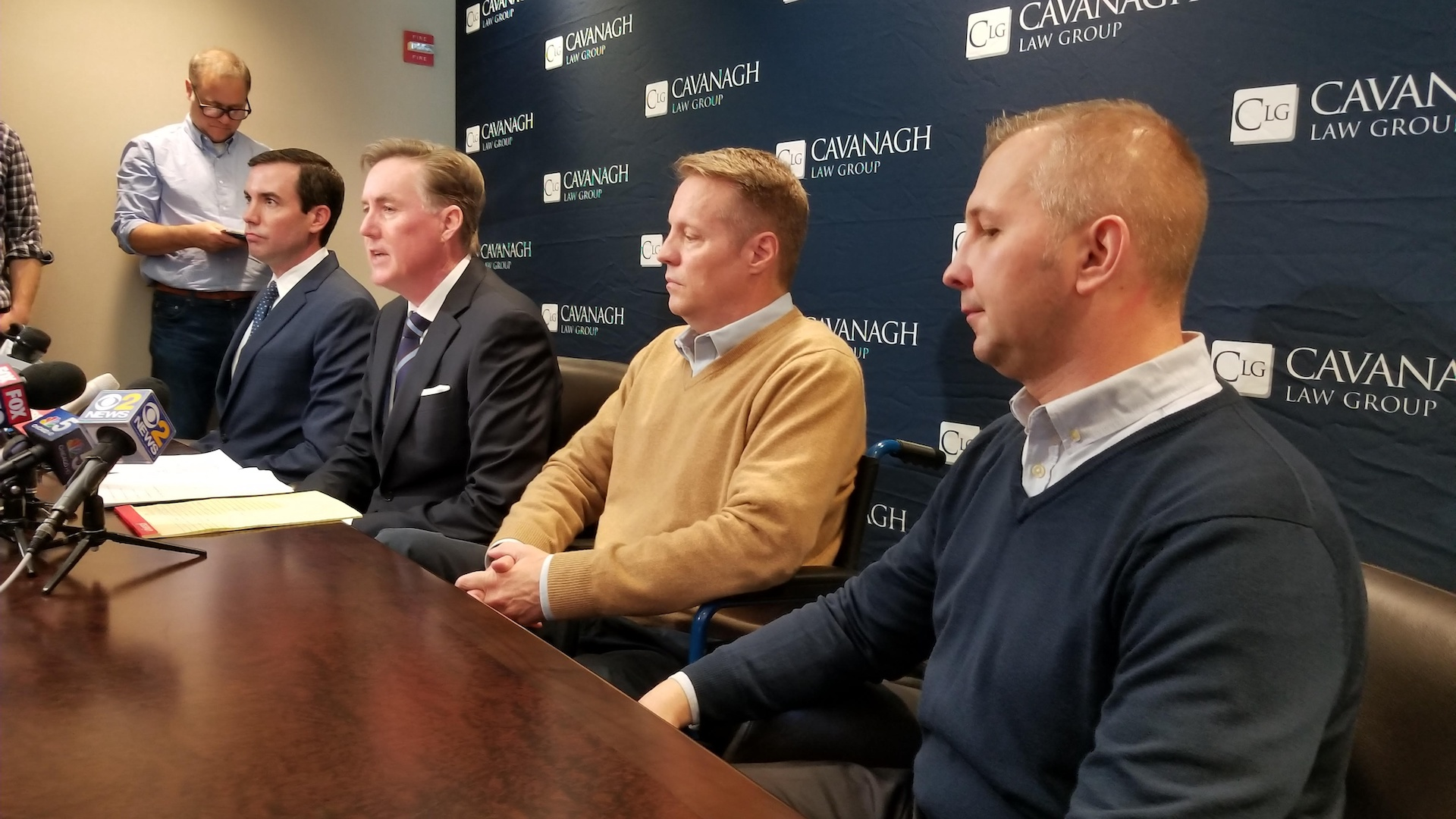 From right: Tomasz Stacha, John Sherwood and attorney Tim Cavanagh discuss their lawsuit. (Matt Masterson / Chicago Tonight)