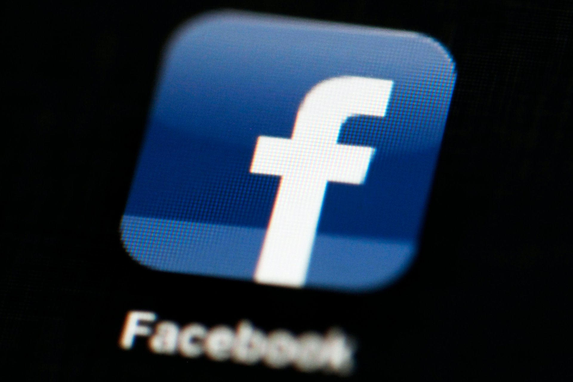 This May 16, 2012 file photo shows the Facebook app logo on a mobile device in Philadelphia. On Monday, Oct. 12, 2020, Facebook announced it is banning posts that deny or distort the Holocaust. (AP Photo / Matt Rourke, File)