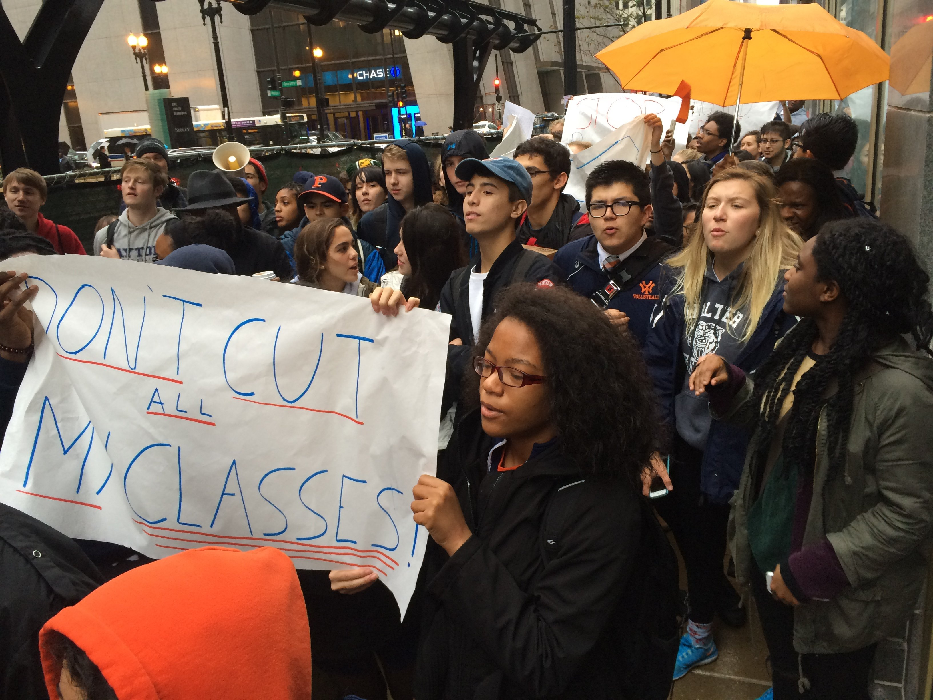 High school students protest at the CPS board meeting.