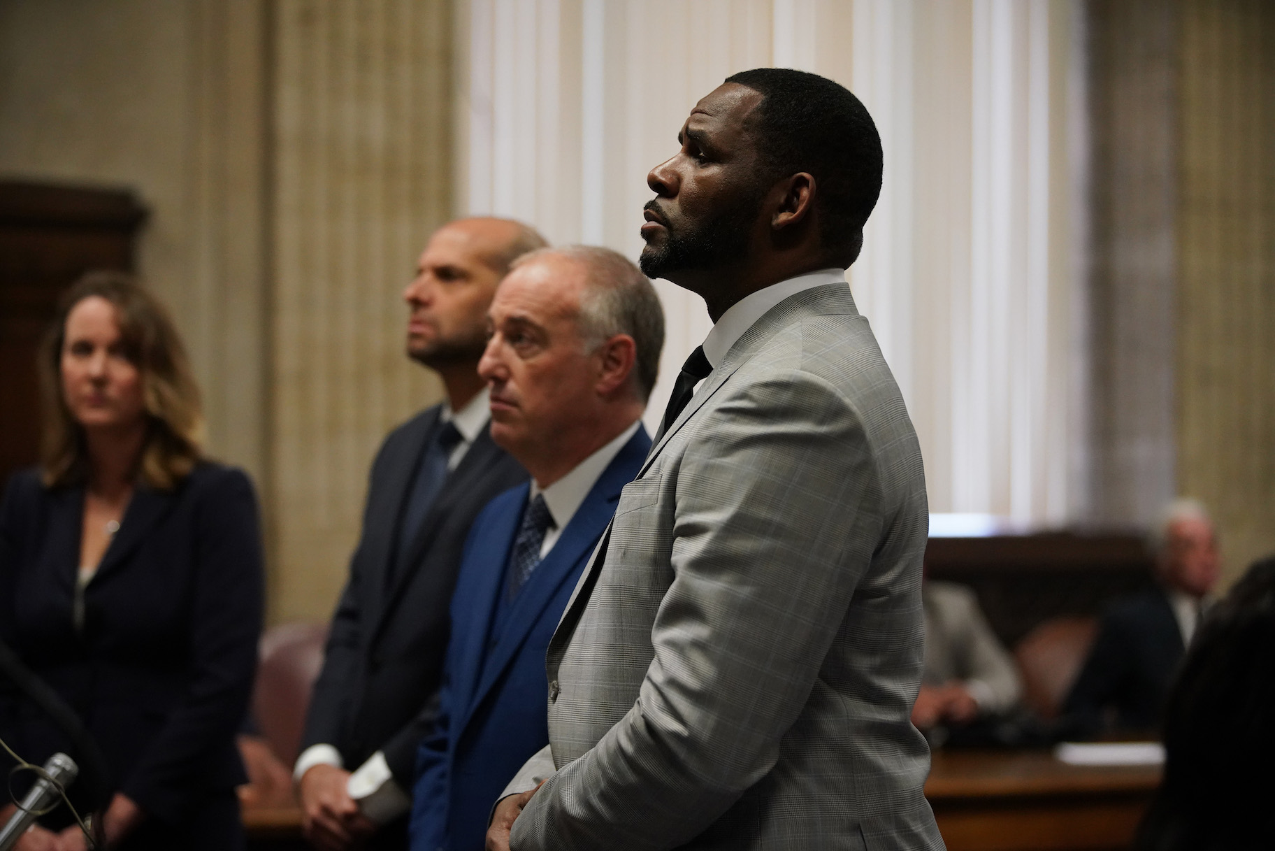 R. Kelly pleaded not guilty to a new indictment before Judge Lawrence Flood with his attorney Steve Greenberg at Leighton Criminal Court Building in Chicago, Thursday, June 6, 2019 (E. Jason Wambsgans/Chicago Tribune/Pool)