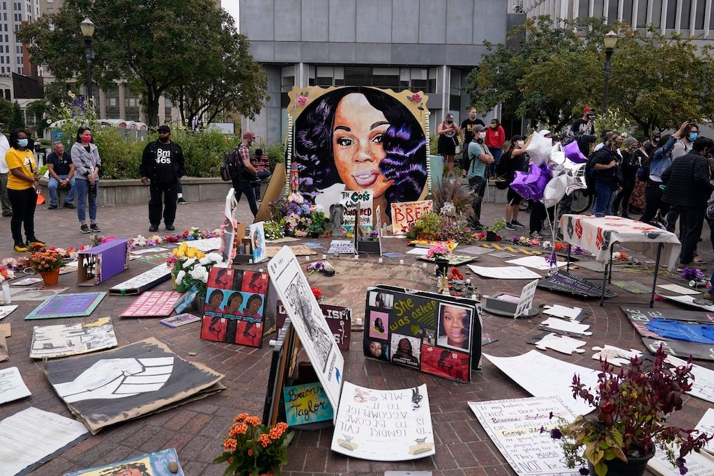 In this Wednesday, Sept. 23, 2020, file photo, people gather in Jefferson Square in Louisville, awaiting word on charges against police officers in the death of Breonna Taylor. (AP Photo/Darron Cummings, File)