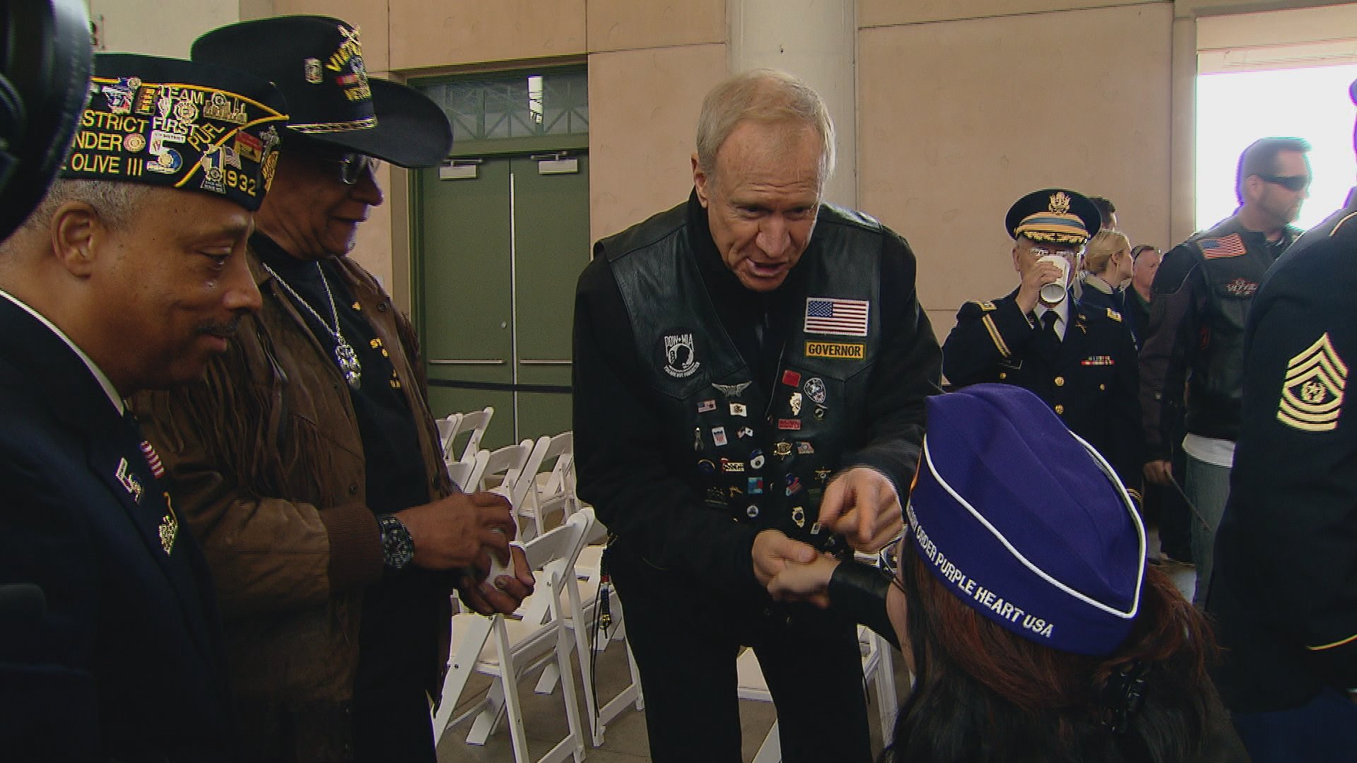Gov. Bruce Rauner greets a veteran at Wednesday's Veteran's Day ceremony at Soldier Field.