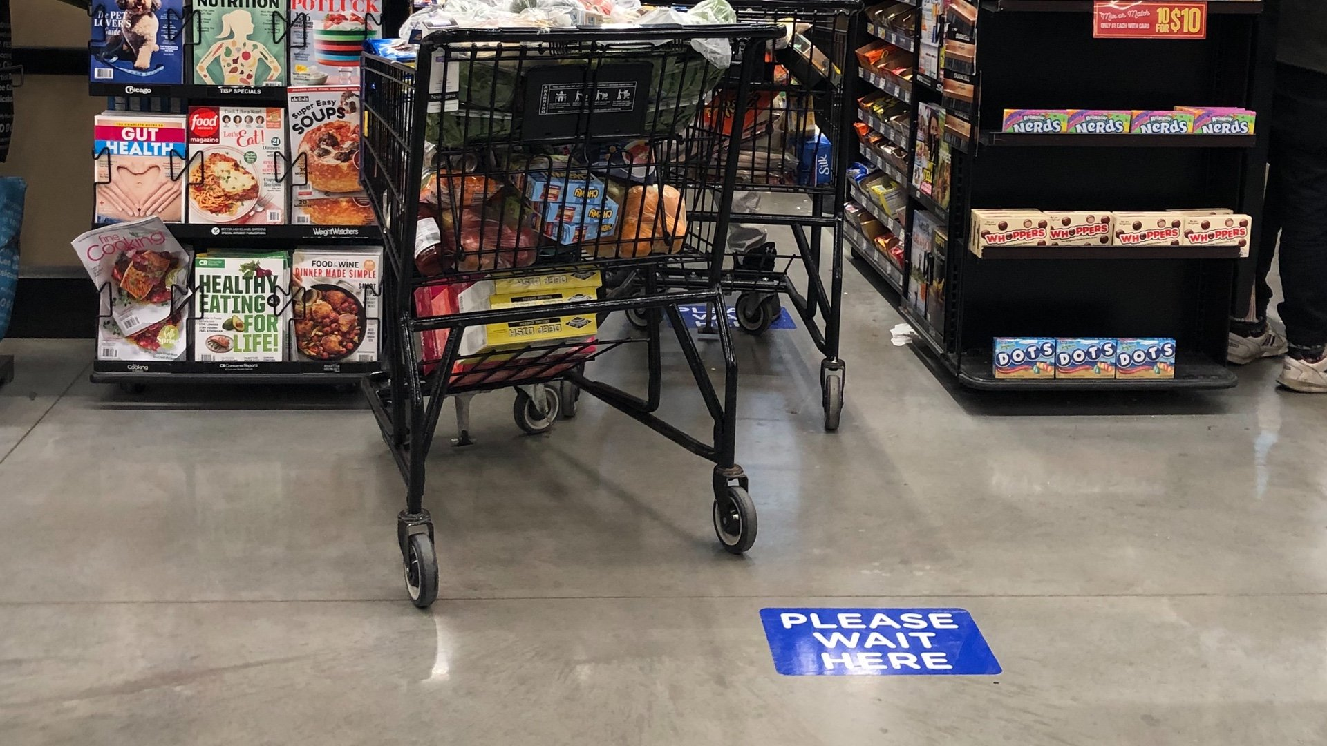 Best practices at grocery stores include social distancing markers in checkout lines. (Patty Wetli / WTTW)