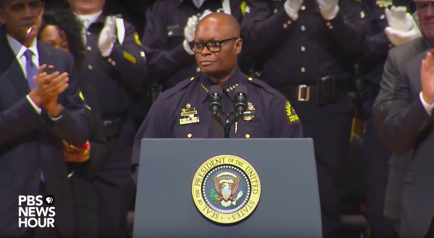 Retired Dallas Police Chief David Brown speaking at a 2016 memorial. (PBS Newshour)