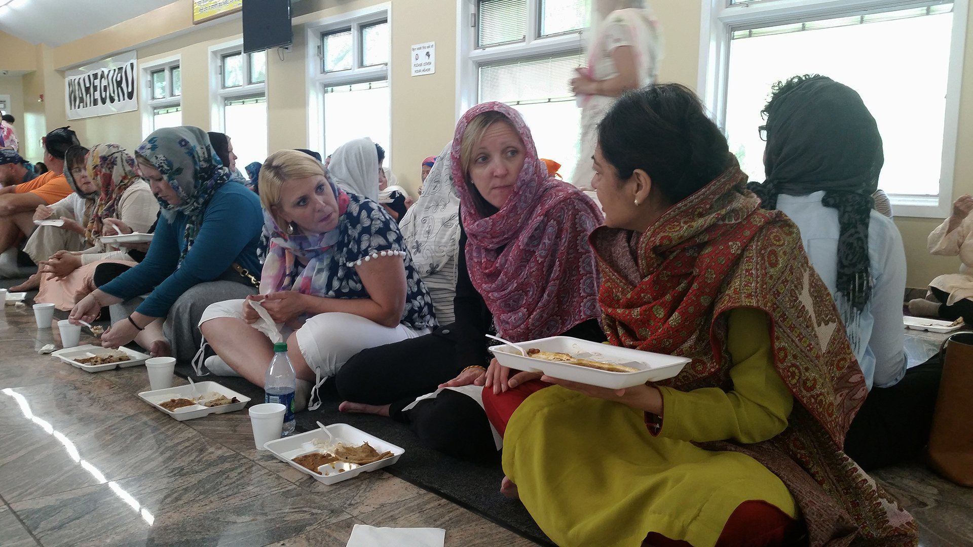 "Suburban Chicago public school teachers take in the traditional ""langer"" meal Tuesday at the Sikh Gurdwara in Palatine. (Matt Masterson / Chicago Tonight)"