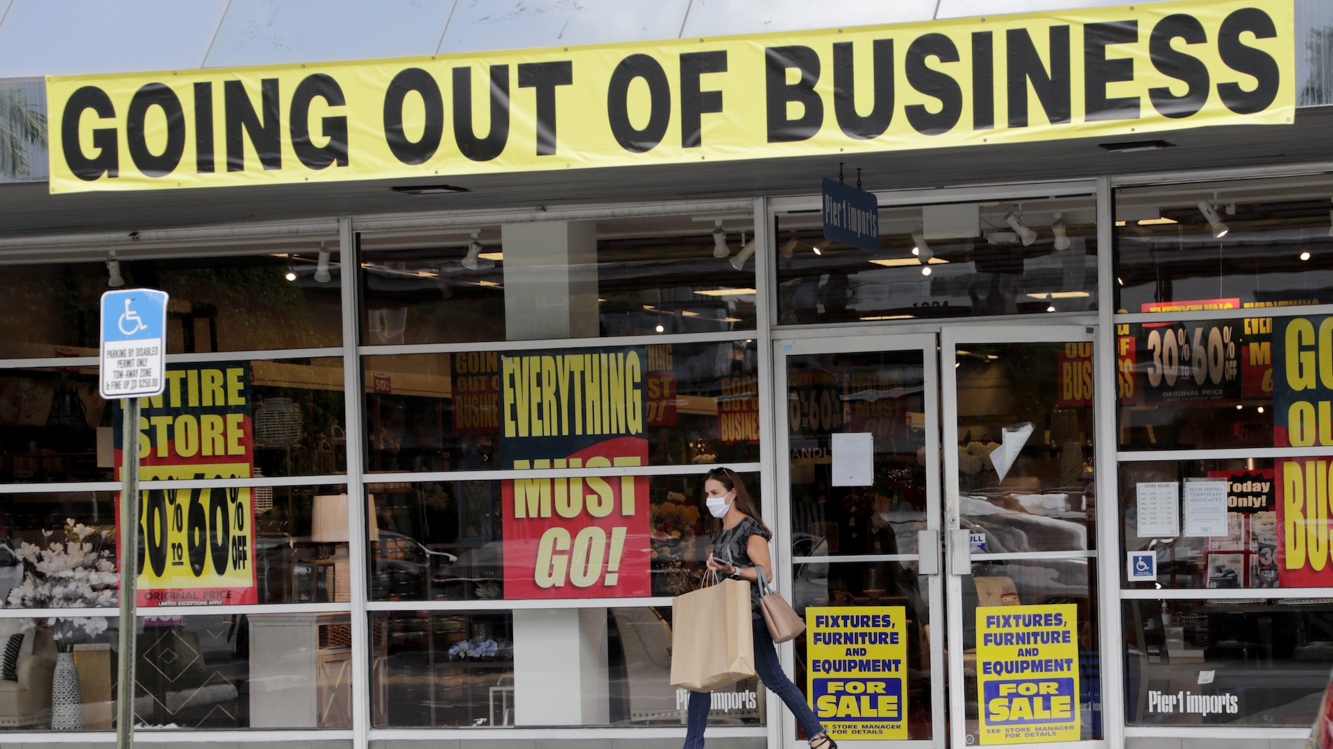 In this Aug. 6, 2020, file photo, a customer leaves a Pier 1 retail store, which is going out of business, during the coronavirus pandemic in Coral Gables, Fla. The Labor Department reported unemployment numbers Thursday, Sept. 3. (AP Photo/Lynne Sladky, File)