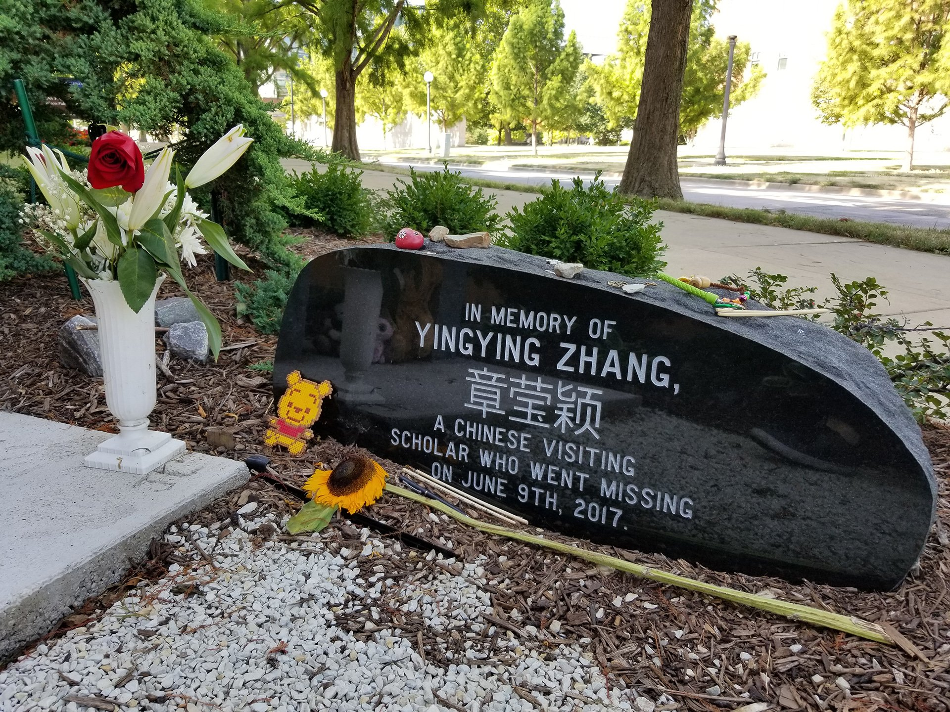 A memorial stone engraved with Yingying Zhang's name in both English and Chinese on the campus of the University of Illinois at Urbana-Champaign on Aug. 7, 2019.  (Matt Masterson / WTTW News)
