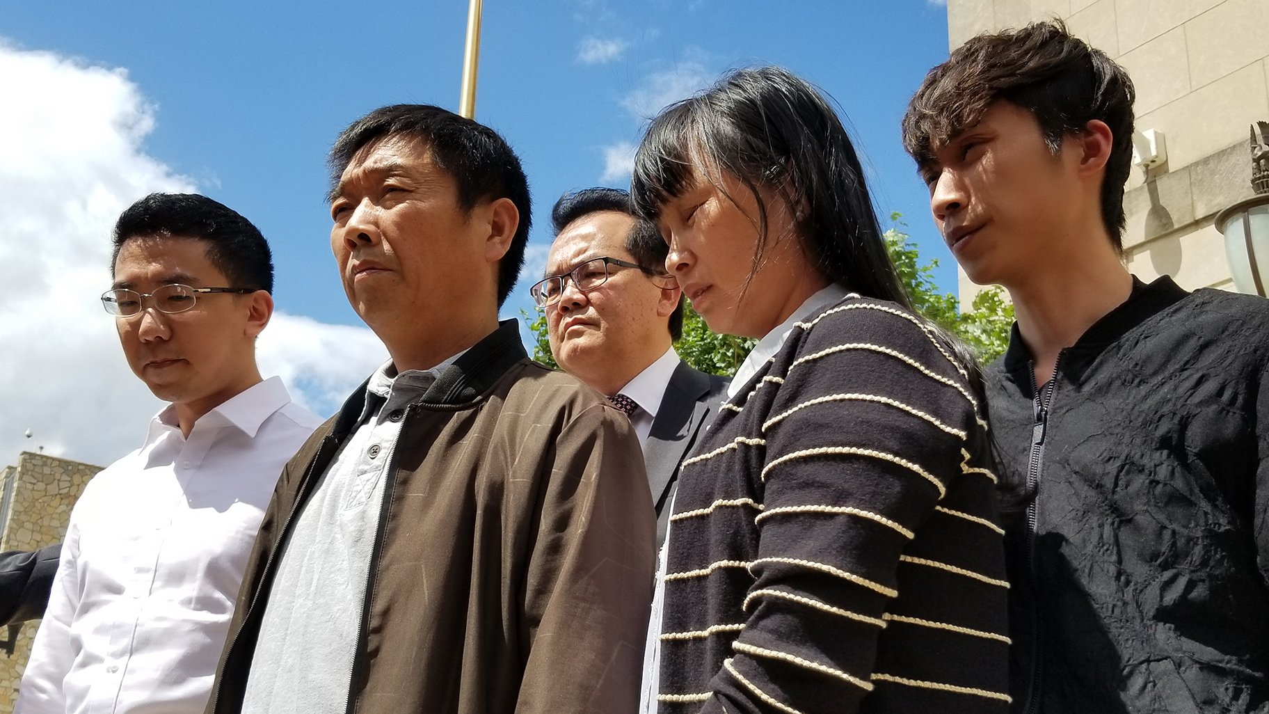 Yingying Zhang's family met with media outside the Peoria federal court building following Brendt Christensen's conviction on June 24, 2019. (Matt Masterson / WTTW News)
