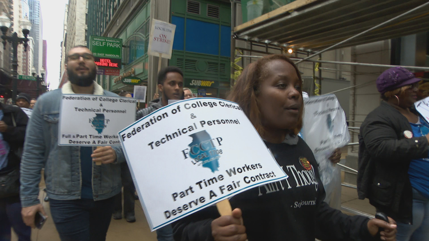City Colleges of Chicago employees march downtown on Wednesday, May 1, 2019. They are demanding a fair contract. (WTTW News)