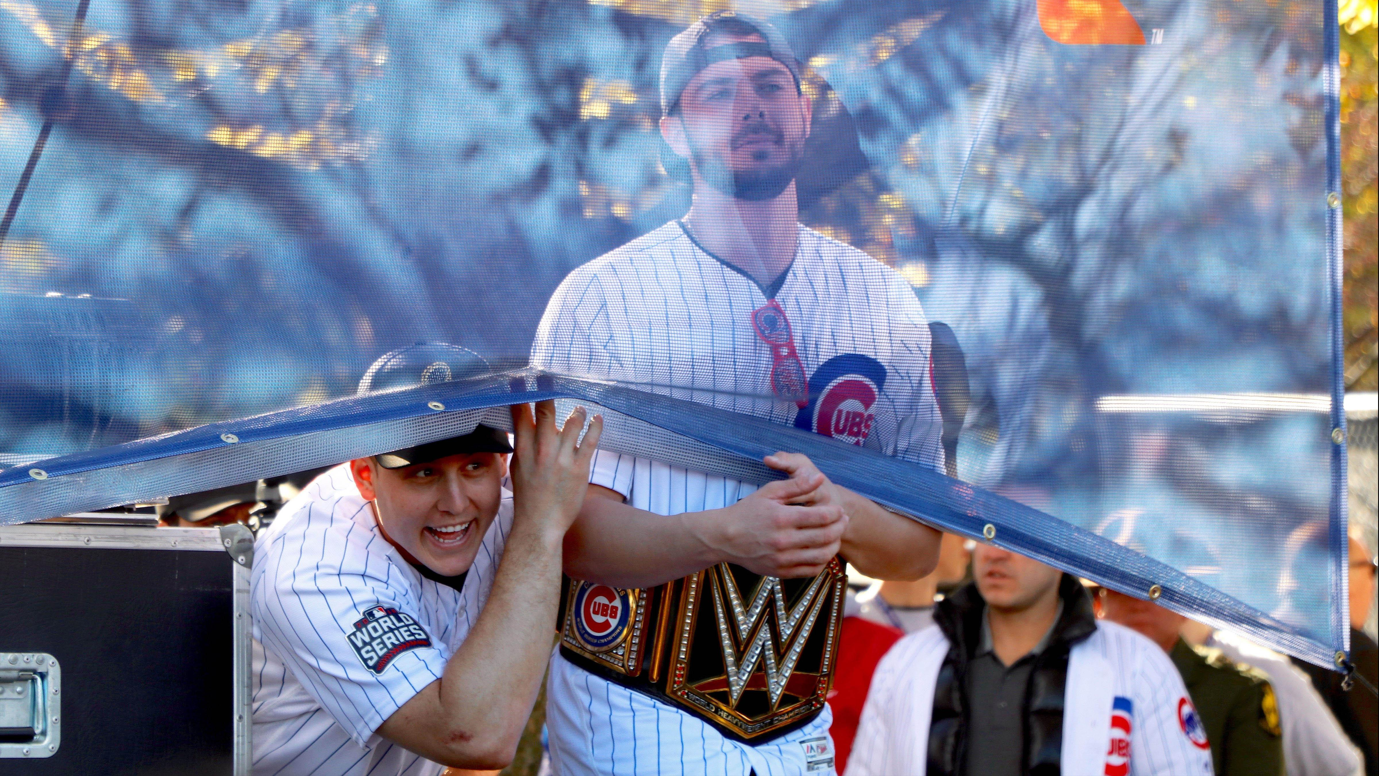 da7963359dd Cubs players Anthony Rizzo and Kris Bryant joke with the crowd before the  team is introduced at the World Series rally in Grant Park.