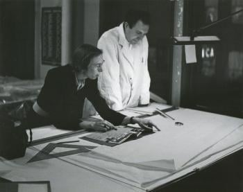 Edith Farnsworth consulting with Myron Goldsmith in the Mies office in 1950.