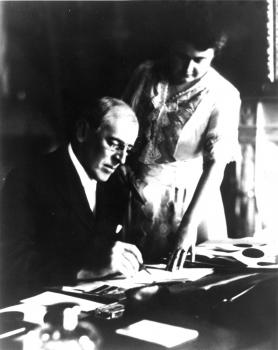 Wilson signing a document with Edith at his side; courtesy Department of Rare Books and Special Collections, Princeton University Library