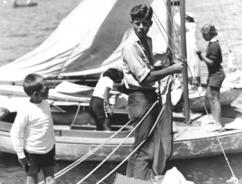 "<em>The Daily Boston Globe</em>'s photo caption: ""Bob advises his brother John how to bend the jib of the <em>Victura.</em>"" Photo courtesy of John F Kennedy Library, July 1934."
