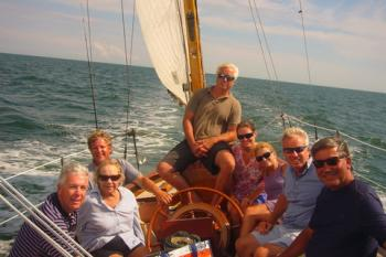 The author (left) aboard <em>Glide</em> with Ethel Kennedy, Ted Kennedy Jr., Max Kennedy, Sheila Kennedy (wife of Chris), Kiki Kennedy (wife of Ted Jr.), Chris Kennedy, and family friend David Nunes. Photo by crewman, August 6, 2012.