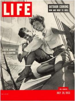 Jack and Jackie, newly engaged, on the bow of <em>Victura</em> and on the cover of <em>Life</em> magazine. Photo courtesy of Hy Peskin's SL & WH, issue dated July 20, 1953.