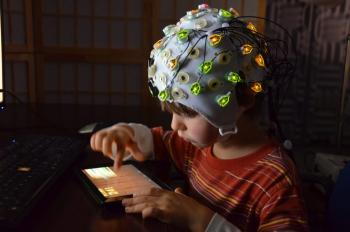Children were monitored with EEGs while watching animated characters perform prosocial and antisocial behaviors, and later participated in a task measuring generosity; courtesy Jean Decety