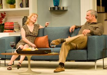 (left to right) Margaret (ensemble member Mariann Mayberry) catches up with her old flame, Mike (Keith Kupferer), in Steppenwolf Theatre Company's production of Good People by Pulitzer Prize-winner David Lindsay-Abaire, directed by ensemble member K. Todd Freeman. Photo Credit: Michael Brosilow