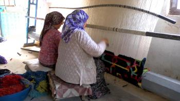 "Turkish weavers harvest the ""fruit of the loom."""