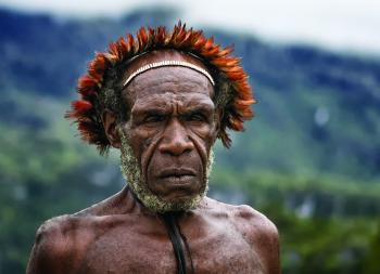 A Dani man, from the Baliem Valley of the New Guinea HIghlands. Credit: Carlo Ottaviano Casana