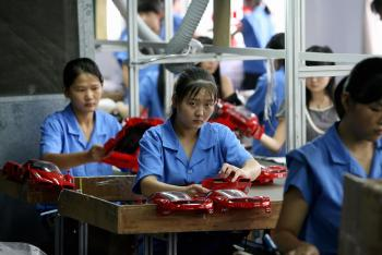 This photo taken 25 September, 2007 shows workers on a production line at a toy factory in Shantou, in China's eastern Guangdong province. Image credit: AFP/Getty Images