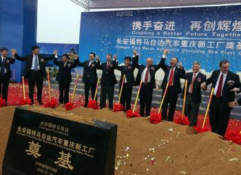 Alan Mulally (fifth from left), chief executive officer of Ford Motor Co., celebrates the new Changan Ford Mazda Automobile plant in Chongqing, China, on Friday, Sept. 25, 2009. Image credit: Doug Kanter/Bloomberg