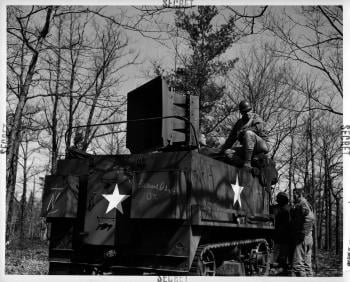 A halftrack with a 500 speaker mounted on the back for sonic deception; courtesy: National Archives
