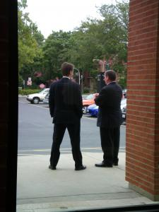 Security waits for the Mayor outside the studio. Click here for photos.