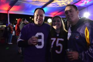 Minnesota Vikings fans Patrick (left) and Nathaniel (right) pose with their friend Chicago Bears fan Lauren (middle).