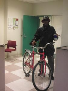 Sammie Lemon poses for a picture with the bike he received through Working Bikes.