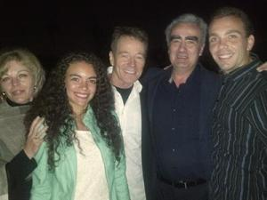 Marius Stan and his family pose for a picture with Bryan Cranston.