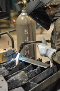 An introductory welding student at Illinois Central College works on an assignment. / Michael Lipkin