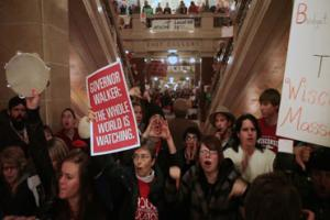 Protestors swarm Wisconsin's capitol in anger about Gov. Walker's decision to end collective bargaining; Courtesy Kartemquin Films and 371 Productions