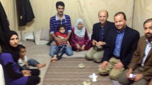Dr. Sahloul having tea with Asma (left) and others
