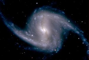 Zoomed-in image from the Dark Energy Camera of the barred spiral galaxy NGC 1365, in the Fornax cluster of galaxies, which lies about 60 million light years from Earth; Photo by Dark Energy Survey Collaboration