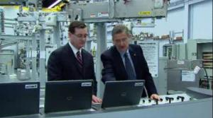 S&C Executive Chairmain, John Estey, inspects an automated distribution control panel