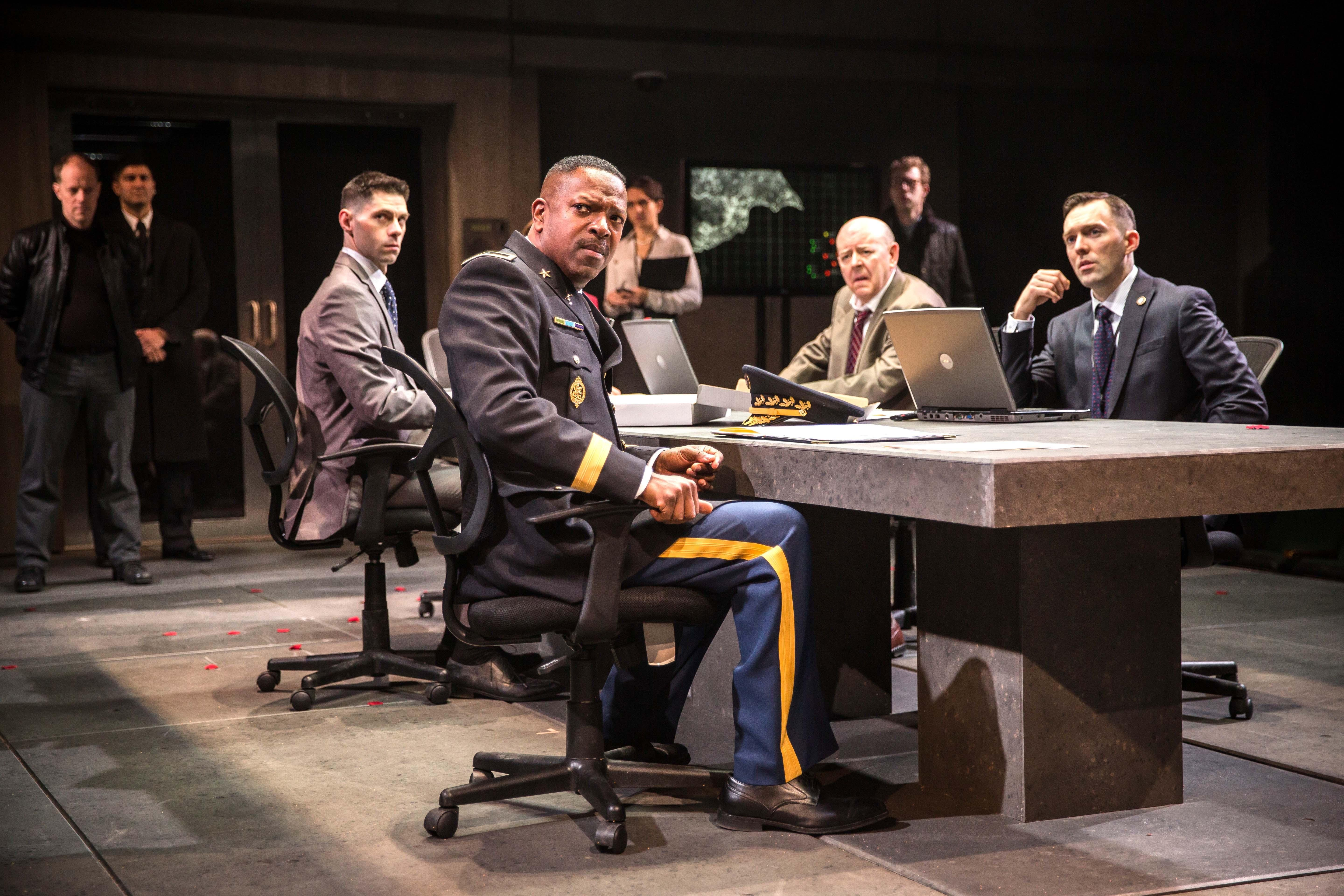 "Othello (James Vincent Meredith, center) is a distinguished commander in the Duke's war council in Chicago Shakespeare Theater's production of ""Othello,"" directed by Jonathan Munby. (Liz Lauren)"