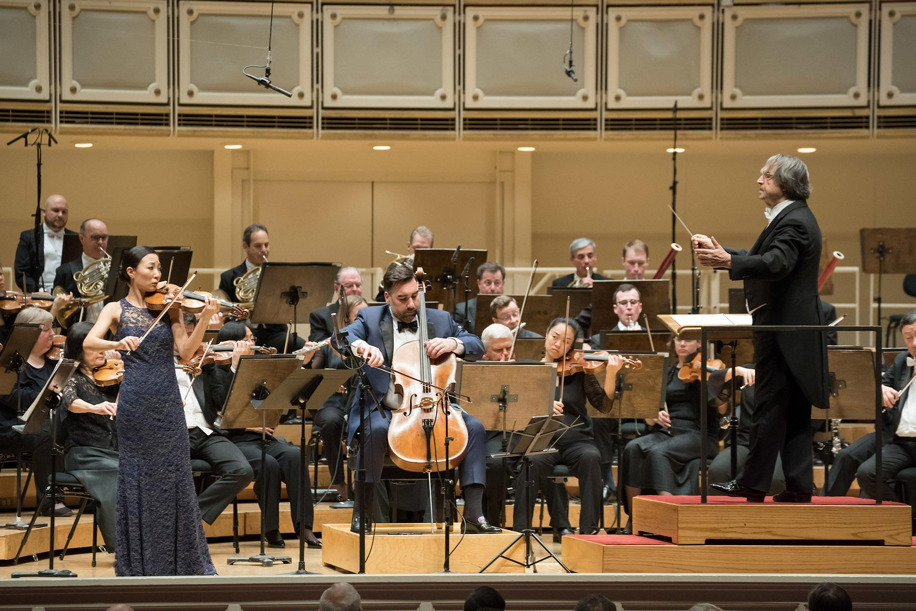 Zell Music Director Riccardo Muti (right) leads the Chicago Symphony Orchestra and Associate Concertmaster Stephanie Jeong (far left) and Assistant Principal Cello Kenneth Olsen (center) in the Brahms Double Concerto at Symphony Center on Nov. 7, 2019. (Credit: Anne Ryan)